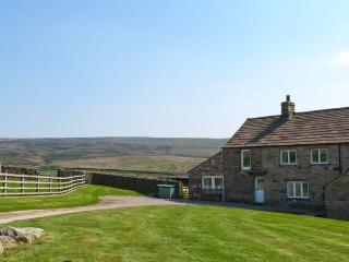 HIGHER CROASDALE FARMHOUSE, pet friendly, character holiday cottage, with a wood
