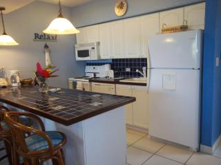 The kitchen has a full size refrigerator, stove, dishwasher and microwave.