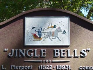 The sign in Troup Square commemorating the writing of 'Jingle Bells' in 1857.