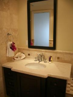 Master bedroom ensuite with bath tub and rain shower