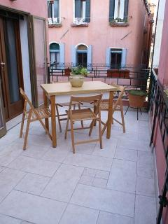 Larger terrace with outdoor dining table