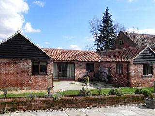 OAK TREE BARN, country holiday cottage with a woodburning stove, broadband and a