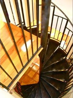 Spiral Staircase Leading To Ensuite Master Bedroom