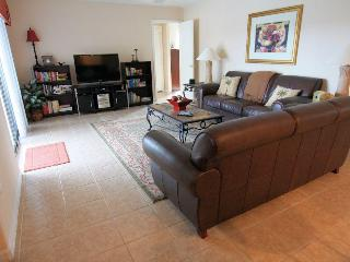 Large, comfortable family room, elegantly furnished to relax after a long day. Flat screen TV, DVD