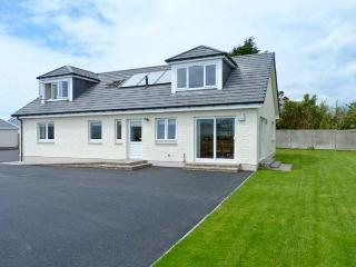 THE QUARE PLACE, detached cottage, four bedrooms, woodburning stove, sea views