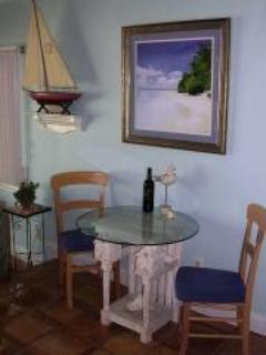 breakfast bar as well has 2 barstools and table & chairs on deck