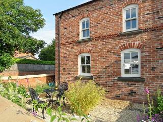 THE LODGE AT CROSS COTTAGE, first floor apartment, open-plan living area, patio, Holt