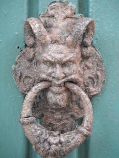 Ancient door knocker in Old San Juan. Knock at your own risk.