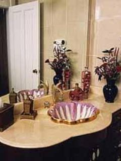 Luxurious baths with all the amenities, 14kt gold hand painted sinks