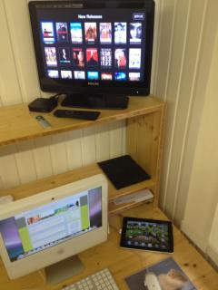 AppleTV with NetFlix movies, iMac and iPad  with free Wifi in and outside the apartment