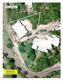 Aireal photo of property showing proximity to Bolongo Bay Beach Resort across the street