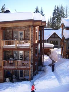 Top floor condo with ski lockers and hot tub in back.