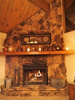 Floor to ceiling wood burning stone fireplace