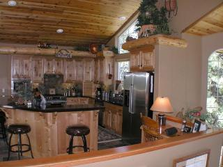 A large gourmet kitchen with granite counters & center island