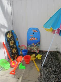 Villa Blanca's outdoor shower and shared beach toys