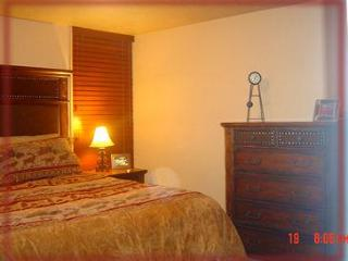 King size bed with luxurious linens and HD flat screen TV
