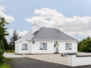 CARNMORE COTTAGE, ground floor cottage with a multi-fuel stove and spacious gard