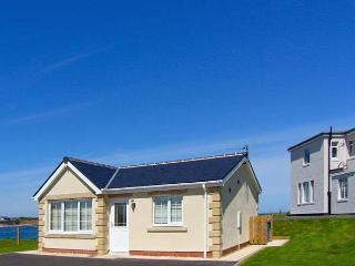 WHITE ROCK COTTAGE, on the coast, stunning sea views, off road parking, with a patio garden, in Beadnell, Ref 17790