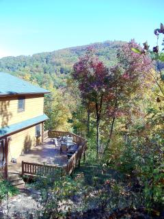 Back of house with large deck and views of Creston mountain