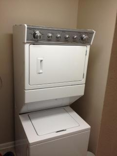 New Washer/Dryer in utility room with iron & ironing board