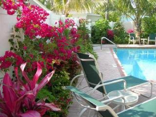 FANTASTIC VALUE! 2 Bedrooms, Heated Pool! Steps to the beach!