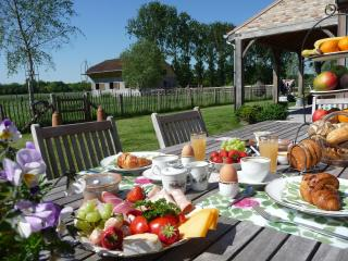 Full breakfast is served, if the weather is fine, on the terrace with views on the vast fields