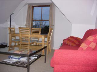 Livng room with dining table and views out to the sea
