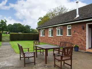 MEADOW LEA, single storey cottage, with off road parking, a garden, and beautiful views, in Orleton, Ref 15436