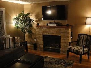 Living Room with Entertainment center-features 52in HDTV,DVD player,Cable TV with DVR,IPOD connect