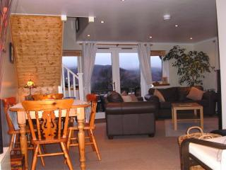 View of the sitting/dining room with view of the loch beyond