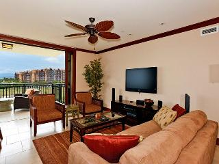 Living Area with Sofa Sleeper, Flat screen TV, ocean view! Ceiling Fans and Central AC in unit.
