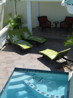 Poolside gazebo for breaks from the sun, if need.