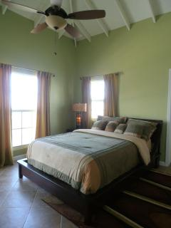 2nd bedroom with 6 foot window which reveals the Atantic Ocean and golf ourse