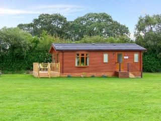 SYCAMORE LODGE, detached timber chalet, with two bedrooms, en-suite bathroom, and decked area, in Hinstock, Ref 19308