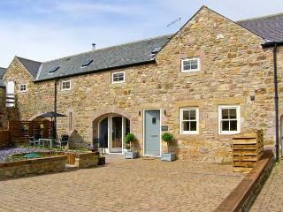 OLD BYRE, near beaches, off road parking, with a patio garden, in Beadnell, Ref 15758