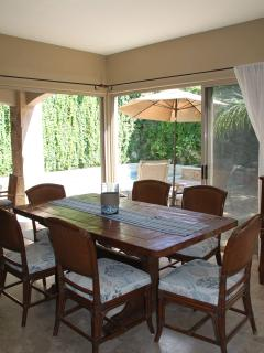 Dining room seats 6 at the table, and 3 at the bar. Large patio doors opne to bring the outside in.