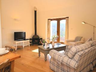 Lounge with flatscreen TV and wood burner