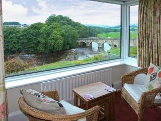 RIVERSIDE, welcoming apartment with river views, off road parking, and garden