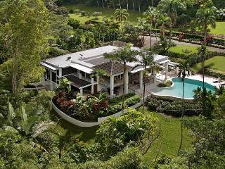 Nestled in 9 acres of manicured lawns, tropical gardens and natural rainforest