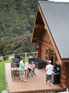 Guests relaxing on the deck of Cascade Creek Retreat