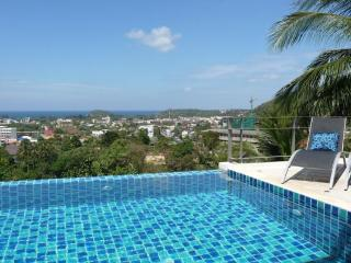 The infinity pool, terrace and stunning views over Kata, the ocean, tropical jungle and Big Buddha