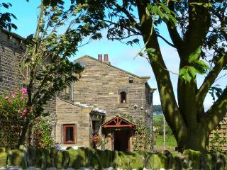 GREEN CLOUGH FARM, beams, woodburner, 6 miles from Haworth in Thornton, Ref 1696