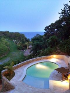 Pool at dusk with Carribean Sea