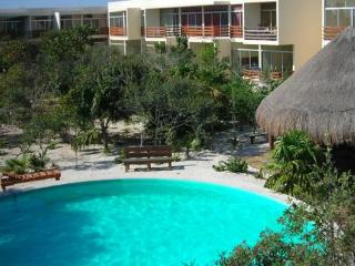 2 bedroom condo with pool, steps to the beach!