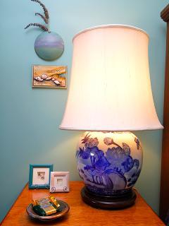 Antique ginger jar lamp provides light on the handmade bedside tables
