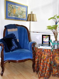 Curl up and read a good book, in this antique Victorian chair, a family heirloom.