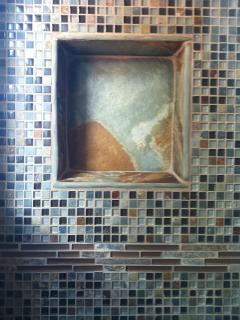 Beautiful niche in shower. We pay attention to detail.