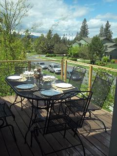 Upstairs balcony deck with dining table, served by mini-bar inside. View of Cascades, Sisters