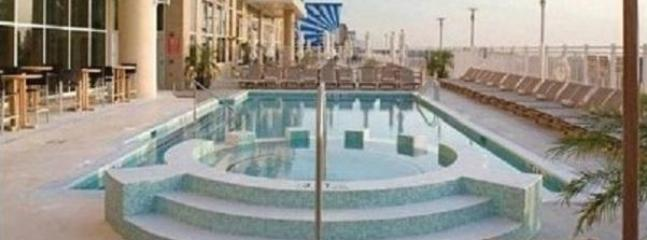 outdoor pool with separte area that can be used for kids