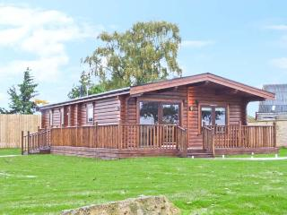 CORNFIELD LODGE, detached log cabin, with en-suite bedroom, designer kitchen